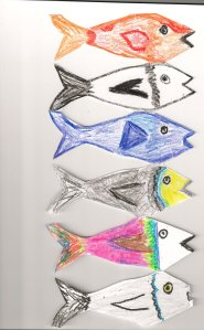 a chain of fish cut out of paper and coloured with crayons
