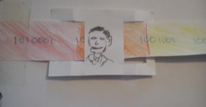 Pencil drawing of a white man on white paper. There is another strip of paper, coloured with red and orange pencils, inserted into holes cut in the white paper.