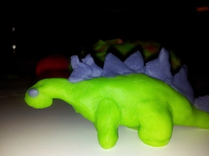 Picture of a green dinosaur with purple spikes, made of playdough