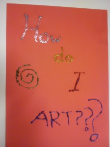 "Red paper, with the words ""How do I ART??"" written in glitter glue"